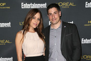 Jenny Mollen (L) and actor Jason Biggs  attend Entertainment Weekly's Pre Emmy Party at the Fig & Olive Melrose Place on August 23, 2014 in West Hollywood, California.