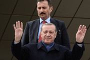 "Turkish President Tayyip Erdogan greets supporters at Ankara Esenboga Airport on April 17, 2017 in Ankara Turkey. Erdogan declared victory in Sunday's historic referendum that will grant sweeping powers to the presidency, hailing the result as a ""historic decision. 51.4 per cent per cent of voters had sided with the ""Yes"" campaign, ushering in the most radical change to the country's political system in modern times.Turkey's main opposition calls on top election board to annul the referendum. OSCE observers said that a Turkish electoral board decision to allow as valid ballots that did not bear official stamps undermined important safeguards against fraud."
