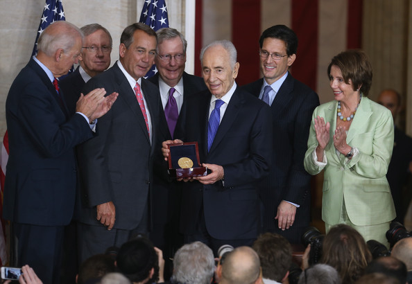 Congress Presents Congressional Gold Medal [shimon peres,joseph biden,president,harry reid,john boehner,eric cantor,r,event,social group,community,businessperson,adaptation,management,employment,official,government,israeli,congressional gold medal,congress]