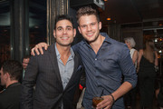 """Eric Podwall (L) and actor Jeremy Irvine attend """"The Evening Before""""- a pre-White House Correspondents' Dinner party hosted by Eric Podwall and Spotify at Chaplin's Restaurant on April 24, 2015 in Washington, DC."""