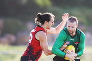 Jake Stringer of Essendon, tipped to be an inclusion for this weekend, is tackled by  Jake Long during an Essendon Bombers AFL training session at The Hangar on July 24, 2018 in Melbourne, Australia.