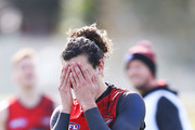 Jake Long of the Bombers kicks the ball at goal but misses during an Essendon Bombers AFL training session at The Hangar on July 26, 2018 in Melbourne, Australia.