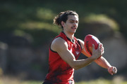 Jake Long of the Bombers  runs with the ball during an Essendon Bombers AFL training session at The Hangar on August 1, 2018 in Melbourne, Australia.