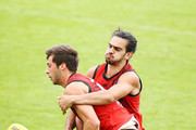 Kyle Langford of the Bombers is tackled by Jake Long during an Essendon Bombers AFL training session at The Hangar on March 20, 2018 in Melbourne, Australia.