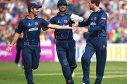 Essex's Tim Phillips (R) celebrates taking the wicket of Darren Stevens of Kent with team mates James Foster (C) and Mark Pettini during the Natwest T20 Blast match between Essex Eagles and Kent Spitfires at Castle Park on July 12, 2014 in Colchester, England.