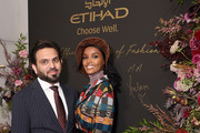 Vice President of Commercial Partnerships for Etihad Airways, Yasser Al Yousef (L) and Halima Aden attend the Etihad Airways cocktail party during NYFW: The Shows at Spring Studios on September 10, 2019 in New York City.