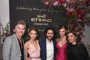 Eric Rutherford, Bambi Northwood Blyth, Etihad Chief Operating Officer, Mohammed Al Balooki, Montana Cox and Etihad Vice President of Brand & Marketing, Amina Taher attend the Etihad Airways cocktail party during NYFW: The Shows at Spring Studios on September 10, 2019 in New York City.