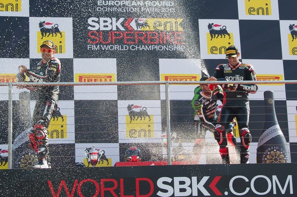 World Superbikes Race [technology,electronic device,podium,stage equipment,endurocross,motorsport,racing,vehicle,spray champagne,sylvain guintoli,tom sykes,l-r,podium,france,aprilia racing team,world superbikes race,race,end]