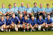 Team Europe. L/R. Graeme McDowell of Northern Ireland, Jamie Donaldson of Wales, Pablo Larrazabal of Spain, Stephen Gallacher of Scotland, Thomas Bjorn of Denmark, The Captain Miguel Angel Jimenez of Spain,  Gonzalo Fernadez-Castano of Spain, Joost Luiten of The Netherlands, Thorbjorn Olesen of Denmark and Victor Dubuisson of France and the teams caddies pictured during the team photocall prior to the EurAsia Cup at the Glenmarie G&CC on March 26, 2014 in Kuala Lumpur, Malaysia.