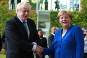 Angela Merkel and Boris Johnson Photos Photo