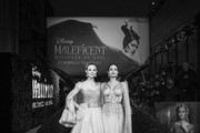 """Image has been converted to black and white)  Elle Fanning (L) and Angelina Jolie attend the European Premiere of Disney's """"Maleficent: Mistress of Evil"""" at Odeon IMAX Waterloo on October 09, 2019 in London, England."""