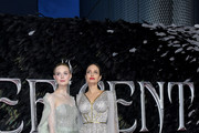 """Elle Fanning (L) and Angelina Jolie attend the European Premiere of Disney's """"Maleficent: Mistress of Evil"""" at Odeon IMAX Waterloo on October 09, 2019 in London, England."""