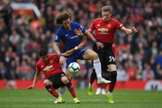 David Luiz of Chelsea battles with Alexis Sanchez and Scott McTominay during the Premier League match between Manchester United and Chelsea FC at Old Trafford on April 28, 2019 in Manchester, United Kingdom.