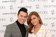 (L-R) CEO of New York & Company Greg Scott poses with Eva Mendes as she visits New York & Company Store on March 15, 2019 in Burbank, California.