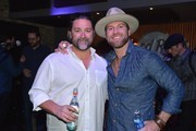 Dot Record's Chris Stacey and Recording Artist Drake White attend an evening with Big Machine Label Group Artists The Cadillac Three (Big Machine Records), Drake White (Dot Records), And Waterloo Revival (Big Machine Records) at Hard Rock Cafe Nashville on February 25, 2015 in Nashville, Tennessee.
