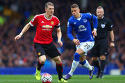 Bastian Schweinsteiger of Manchester United and Ross Barkley of Everton compete for the ball during the Barclays Premier League match between Everton and Manchester United at Goodison Park on October 17, 2015 in Liverpool, England.