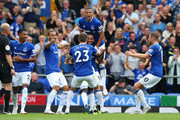 Theo Walcott of Everton celebrates after scoring his team's first goal with team mates during the Premier League match between Everton FC and Southampton FC at Goodison Park on August 18, 2018 in Liverpool, United Kingdom.