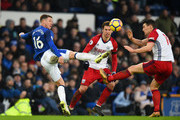 James McCarthy of Everton is challenged by Gareth Barry of West Bromwich Albion during the Premier League match between Everton and West Bromwich Albion at Goodison Park on January 20, 2018 in Liverpool, England.