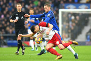 Gylfi Sigurdsson of Everton challenges Gareth Barry of West Bromwich Albion during the Premier League match between Everton and West Bromwich Albion at Goodison Park on January 20, 2018 in Liverpool, England.