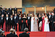 """(L-R) Cannes Film Festival President Pierre Lescure, Producer Alexandre Mallet-Guy, actor Eduard Fernandez, Javier Bardem, director Asghar Farhadi and actress Penelope Cruz, wearing jewels by Atelier Swarovski Fine Jewelry, actor  Ricardo Darin, actress Sara Salamo, actress Carla Campra, actress Elvira Minguez, Barbara Lennie, Inma Cuesta, Producer Alvaro Longoria and Cannes Film Festival Director Thierry Fremaux attend the screening of """"Everybody Knows (Todos Lo Saben)"""" and the opening gala during the 71st annual Cannes Film Festival at Palais des Festivals on May 8, 2018 in Cannes, France."""