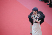 """Singer Li Yuchun attends the screening of """"Everybody Knows (Todos Lo Saben)"""" and the opening gala during the 71st annual Cannes Film Festival at Palais des Festivals on May 8, 2018 in Cannes, France."""