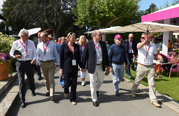 Franck Riboud, President of the Evian Championship and CEO of Danone, Prince Albert II of Monaco, Princess Charlene of Monaco and Jaques Bungert, Evian Championship Director visit the Evian Championship village during the final round of The Evian Championship at the Evian Resort Golf Club on September 14, 2014 in Evian-les-Bains, France.