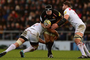 Thomas Waldrom of Exeter Chiefs is tackled by Michael Fitzgerald and Tafafu Polota-Nau of Leicester Tigers during the Aviva Premiership match between Exeter Chiefs and Leicester Tigers at Sandy Park on December 31, 2017 in Exeter, England.
