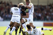 Aly Muldowney of Exeter is tackled by Corne Uys (L) and Andy Powell (R) of Sale during the Aviva Premiership match between Exeter Chiefs and Sale Sharks at the Sandy Park Stadium on September 1, 2012 in Exeter, England.