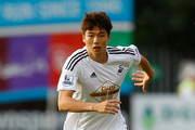 Sung-Yeung Ki of Swansea City in action during the pre season friendly match between Exeter City and Swansea City at St. James Park on July 29, 2014 in Exeter, England.