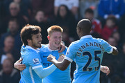Kevin de Bruyne (C) of Manchester City celebrates scoring his team's second goal with his team mates David Silva (L) and Fernandinho (R) during the Barclays Premier League match between A.F.C. Bournemouth and Manchester City at Vitality Stadium on April 2, 2016 in Bournemouth, England.