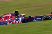 Jaime Alguersuari of Spain and Scuderia Toro Rosso drives during qualifying for the Brazilian Formula One Grand Prix at the Autodromo Jose Carlos Pace on November 26, 2011 in Sao Paulo, Brazil.