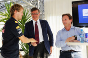 Sebastian Vettel (L) of Germany and Red Bull Racing is seen with his Team Principal Christian Horner (R) and GEOX Chairman Mario Moretti Polegato (C) at a press conference during previews to the Italian Formula One Grand Prix at the Autodromo Nazionale di Monza on September 8, 2011 in Monza, Italy.