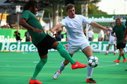 Max Verstappen of Netherlands and Red Bull Racing and Christian Karembeu of France stretch for the ball during the Heineken Champions of the Grid Charity football match during previews for the Formula One Grand Prix of Italy at Autodromo di Monza on September 1, 2016 in Monza, Italy.