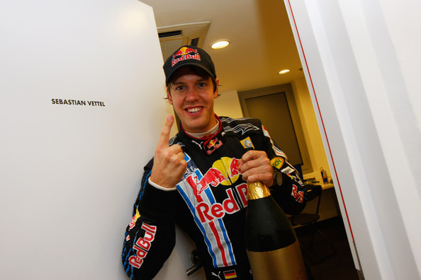 Sebastian Vettel of Germany and Red Bull Racing celebrates in his changing room after winning the Abu Dhabi Formula One Grand Prix at the Yas Marina Circuit on November 1, 2009 in Abu Dhabi, United Arab Emirates.