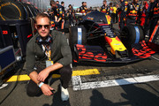 Actor Alexander Skarsgard poses for a photo with the car of Max Verstappen of Netherlands and Red Bull Racing on the grid before the F1 Grand Prix of Australia at Melbourne Grand Prix Circuit on March 17, 2019 in Melbourne, Australia.