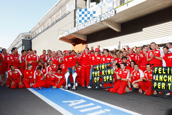 Kimi Raikkonen of Finland and Ferrari celebrates with team mates in the pitlane after winning the Belgian Grand Prix at the Circuit of Spa Francorchamps on August 30, 2009 in Spa Francorchamps, Belgium.