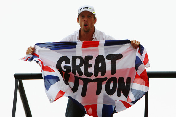 Jenson Button of Great Britain and Brawn GP celebrates clinching the F1 World Drivers Championship during the Brazilian Formula One Grand Prix at the Interlagos Circuit on October 18, 2009 in Sao Paulo, Brazil.