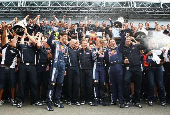 (L-R) Second placed Mark Webber of Australia and Red Bull Racing, Red Bull Racing designer Adrian Newey, Red Bull Racing Team Principal Christian Horner and race winner Sebastian Vettel of Germany and Red Bull Racing are sprayed with champagne by team mates in the paddock following the British Formula One Grand Prix at Silverstone on June 21, 2009 in Northampton, England.