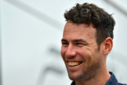 Cycling superstar Mark Cavendish of Great Britain walks in the Paddock before the Formula One Grand Prix of Great Britain at Silverstone on July 16, 2017 in Northampton, England.