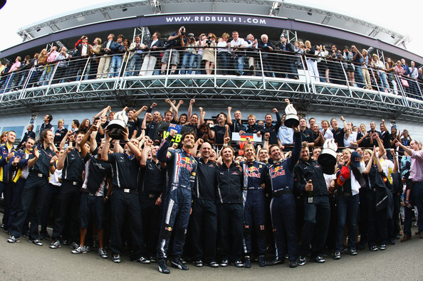 Red Bull Racing team celebrate victory for their driver Sebastian Vettel of Germany in the British Formula One Grand Prix at Silverstone on June 21, 2009 in Northampton, England.