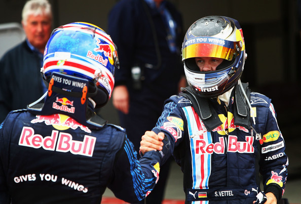 Sebastian Vettel (R) of Germany and Red Bull Racing celebrates with second placed Mark Webber (L) of Australia and Red Bull Racing in parc ferme after winning the British Formula One Grand Prix at Silverstone on June 21, 2009 in Northampton, England.