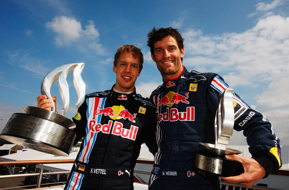 Race winner Sebastian Vettel (L) of Germany and Red Bull Racing celebrates with second placed Mark Webber (R) of Australia and Red Bull Racing following the British Formula One Grand Prix at Silverstone on June 21, 2009 in Northampton, England.
