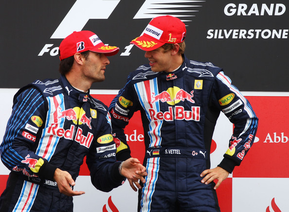 Sebastian Vettel (R) of Germany and Red Bull Racing celebrates with second placed Mark Webber (L) of Australia and Red Bull Racing on the podium after winning the British Formula One Grand Prix at Silverstone on June 21, 2009 in Northampton, England.