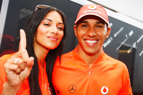 Lewis Hamilton of Great Britain and McLaren Mercedes and his girlfriend Nicole Scherzinger of the Pussycat Dolls celebrate after he wins the Hungarian Formula One Grand Prix at the Hungaroring on July 26, 2009 in Budapest, Hungary.