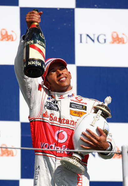 Lewis Hamilton of Great Britain and McLaren Mercedes celebrates on the podium after winning the Hungarian Formula One Grand Prix at the Hungaroring on July 26, 2009 in Budapest, Hungary.