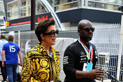 Kris Jenner and Corey Gamble walk in the Paddock before the Monaco Formula One Grand Prix at Circuit de Monaco on May 27, 2018 in Monte-Carlo, Monaco.