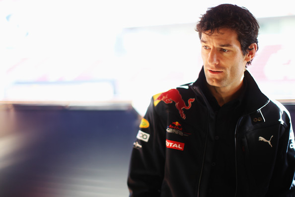 Mark Webber of Australia and Red Bull Racing talks to media in his team garage during a filming day prior to Formula One winter testing at the Circuit De Catalunya on February 24, 2010 in Barcelona, Spain.