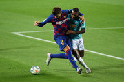 Gerard Pique of FC Barcelona is challenged by Estupinan of Osasuna during the Liga match between FC Barcelona and CA Osasuna at Camp Nou on July 16, 2020 in Barcelona, Spain.