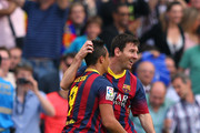 Alexis Sanchez of FC Barcelona celebrates with Lionel Messi after scoring the opening goal during the La Liga match between FC Barcelona and Club Atletico de Madrid at Camp Nou on May 17, 2014 in Barcelona, Spain.