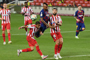 Arturo Vidal (C) of FC Barcelona misses a chance to score against Felipe (R) of Atletico Madrid during the Liga match between FC Barcelona and Club Atletico de Madrid at Camp Nou on June 30, 2020 in Barcelona, Spain.
